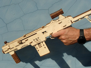 Rubber band gun Automatic pistol made of plywood shoots with furniture dowels