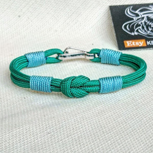 Thin Viking paracord bracelet with a carabiner.  Made of parachute cord and celtic knots.  Gift to a friend for his birthday.