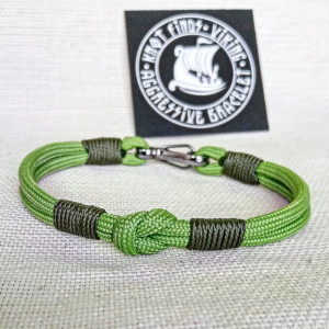 Thin green Viking paracord bracelet with a carabiner.  Made of parachute cord and celtic knots.  Gift to a friend for his birthday.