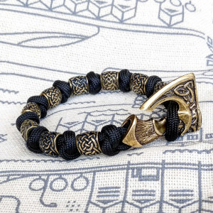 Viking bracelet made of paracord, Celtic knots and original beads made of brass with the image of ancient Scandinavian patterns. Mens style.