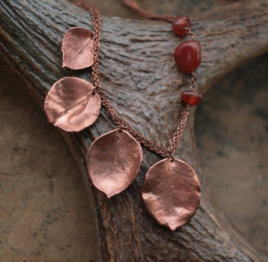 Asymmetric carnelian necklace with real pear leaves, copper electroformed metal leaf, botanical jewelry, Art Nouveau style, asymmetry