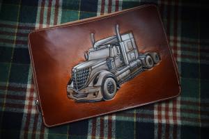 International truck. Leather tooled documents folder.
