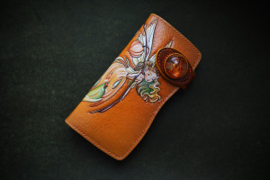 Lantern Fairy. Long leather tooled wallet with physalis concho.