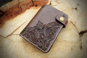 Baroque. Middle tooled leather wallet.