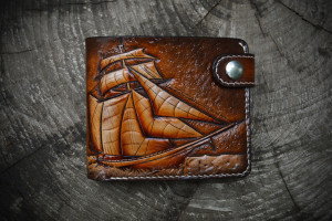 Sail. Short leather tooled wallet.