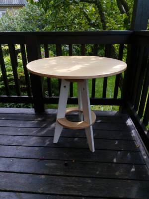 Flat pack, folding plywood table, round table in scandinavian style.