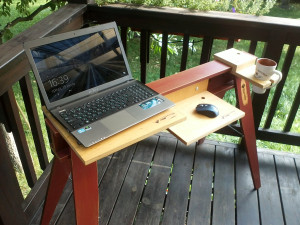 Foldable, convertible, table for a laptop.