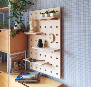 Pegboard wall, pegboard organizer, plywood peg board shelf, office pegboard. Natural polished plywood board without coating.