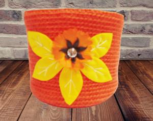 Orange knitted basket with flower