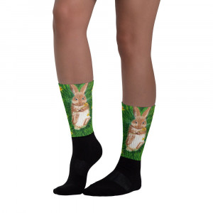Socks Rabbit. These socks are extra comfortable thanks to their cushioned bottom. The foot is black with artwork printed along the leg.