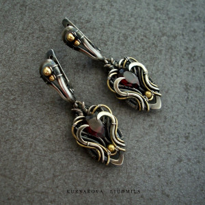 Sterling silver earrings for woman with garnets and brass in the Gothic style